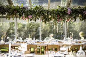 A frame marquee with suspended floral runner