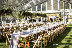 Inside marquee with suspended floral runner