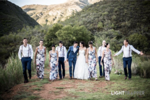 Bridal party walking on the mountain path