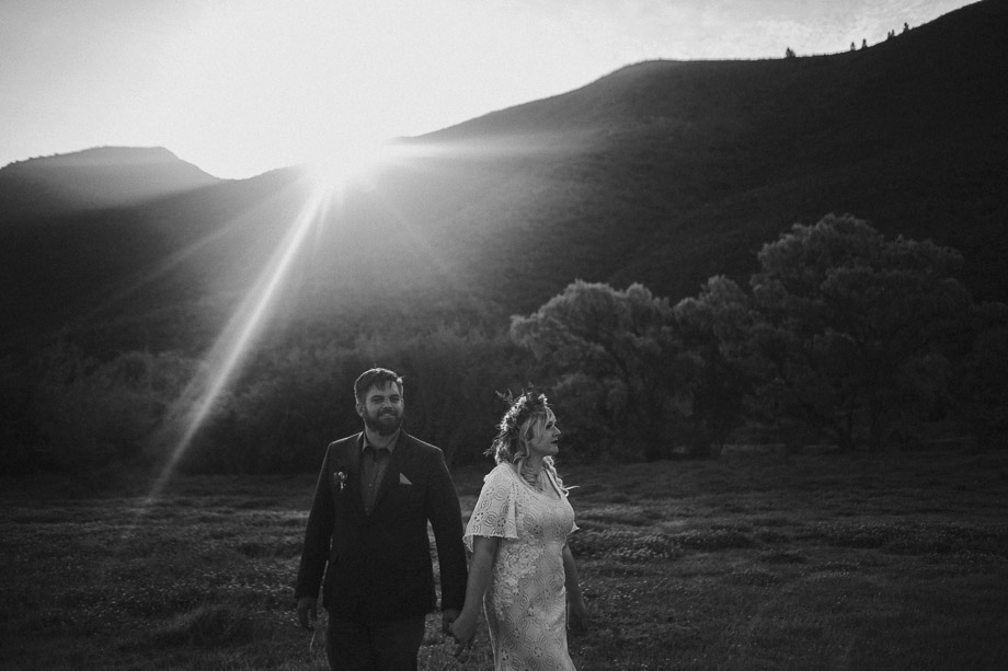 Wedding couple in field at Pat Busch Mountain Reserve