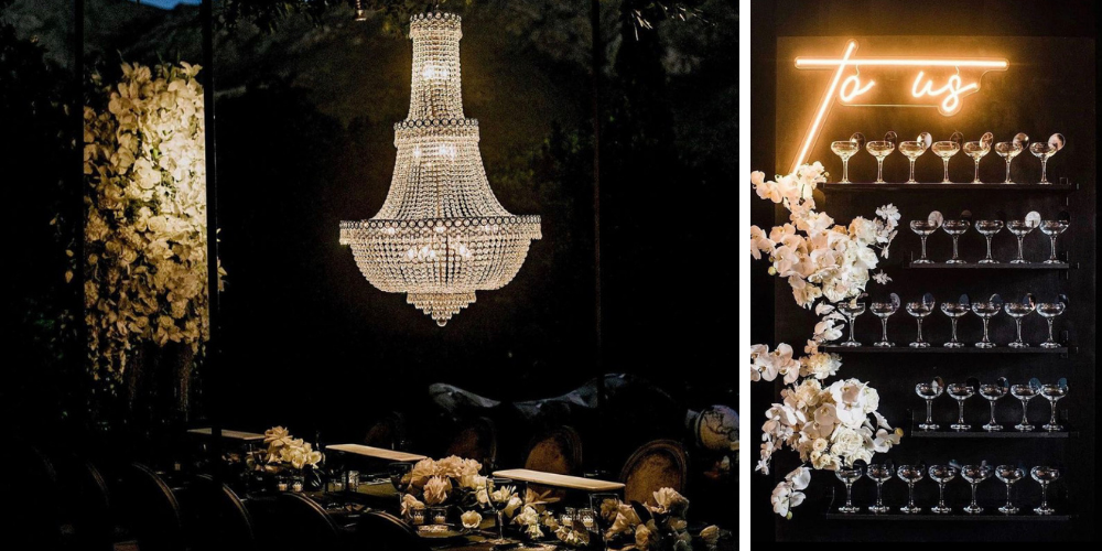 Wedding reception at night with over-sized chandelier above tables
