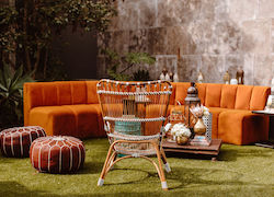 Orange couch and chairs outside in garden