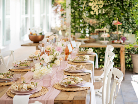 Outdoor table with pink table decor and flowers