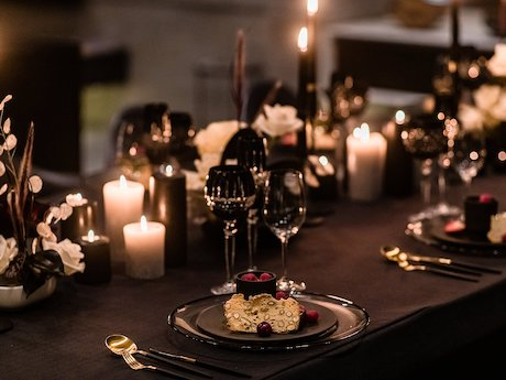 Dinner table set with cut crystal glasses and dessert