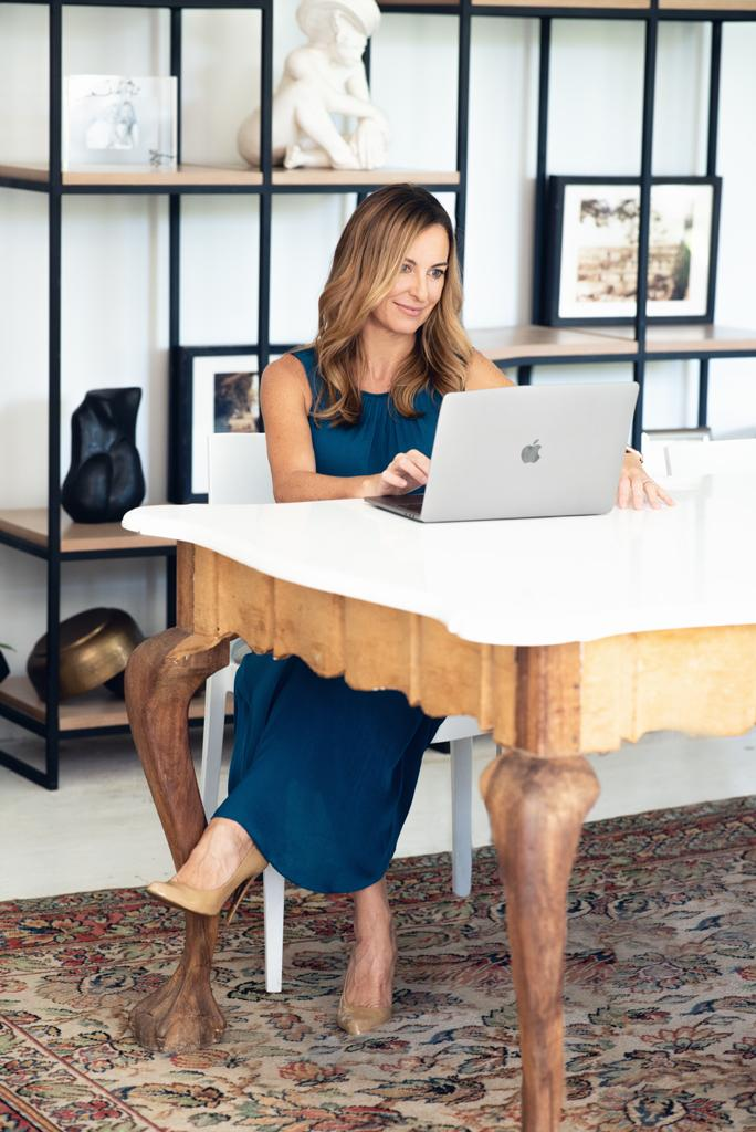 Business woman and owner of Boutique Events sitting in office